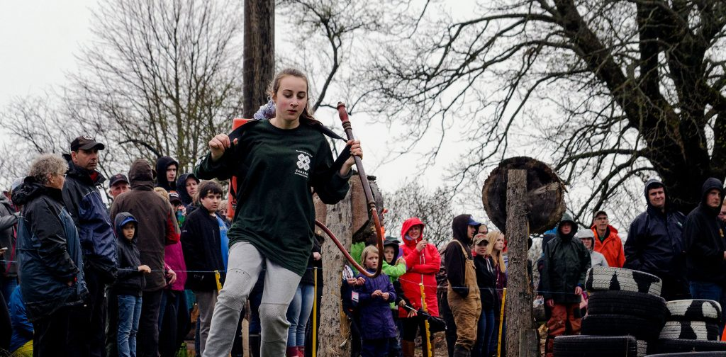 Girl running woodsman course