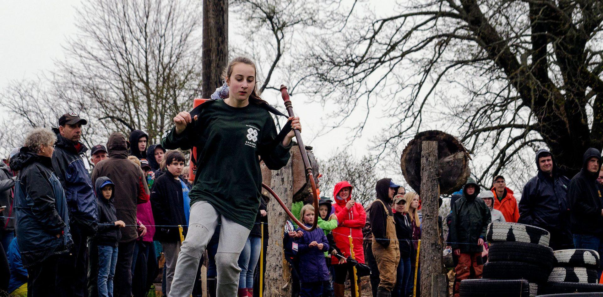 Girl running woodsman course