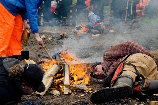 Woodsmen starting a fire