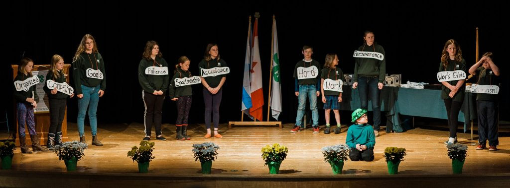 Group on stage at 4-H Weekend