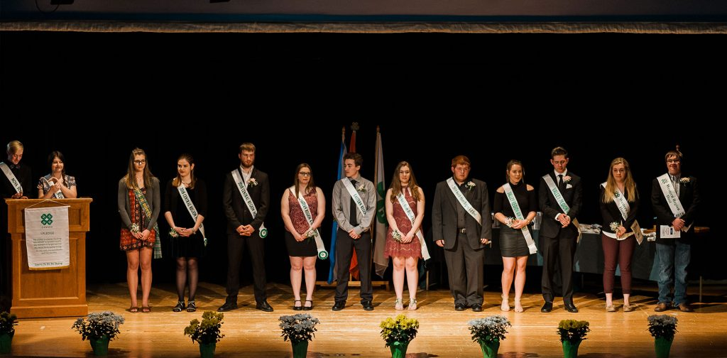 4-H Club members on stage receiving awards