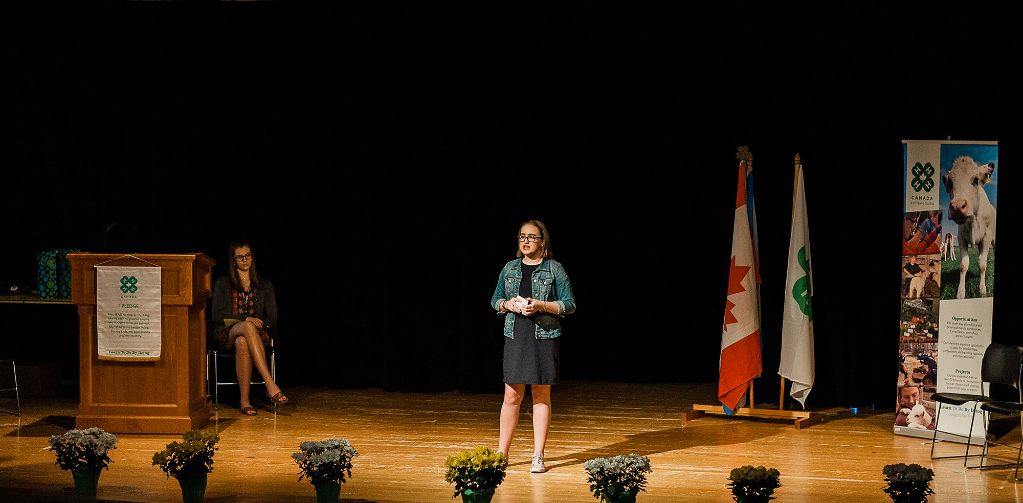 Girl on stage doing public speaking presentation