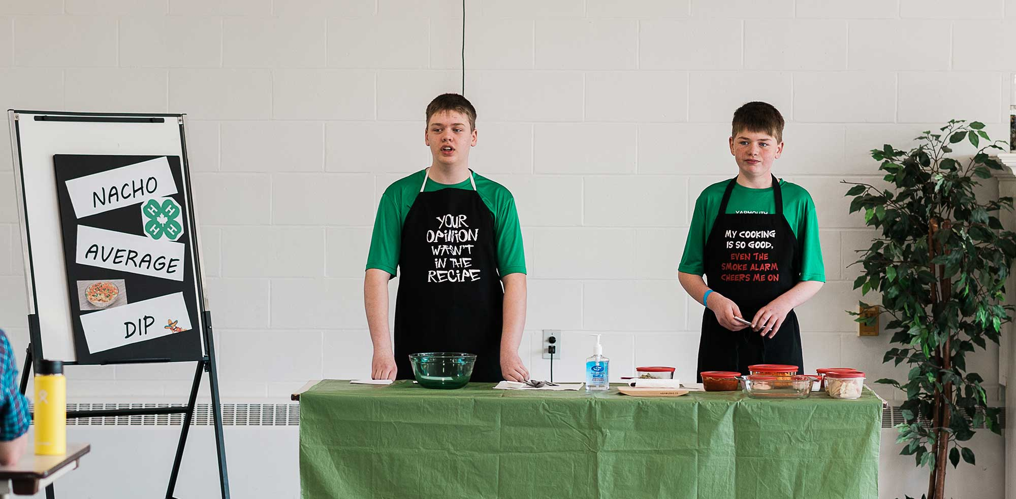 Boys demonstrating nacho recipe