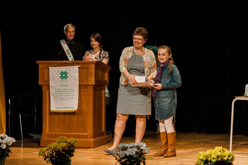 Girl receiving award at 4-H Weekend 18