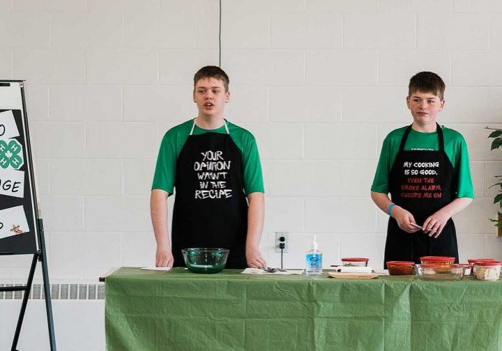 Boys demonstrating nacho recipe